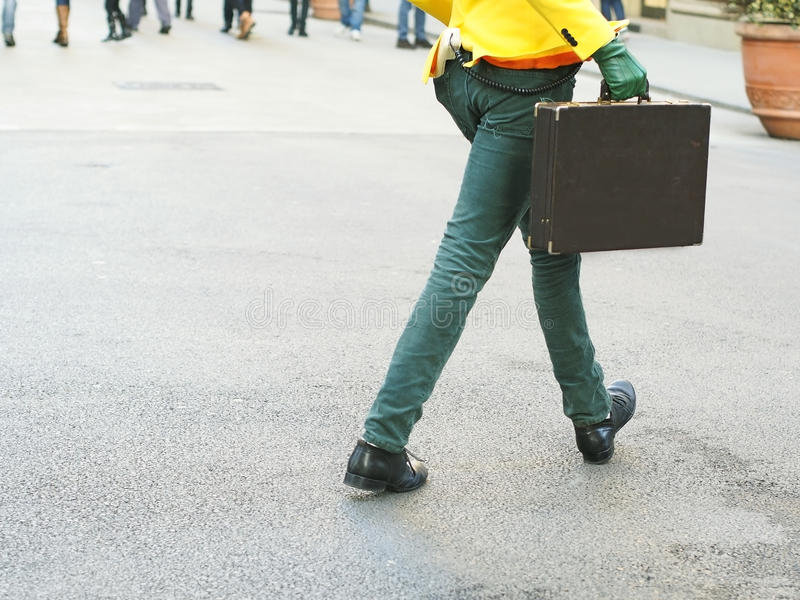 Download Extravagant Man Walking With A Briefcase Stock Photo - Image of pavement, suitcase: 36696108