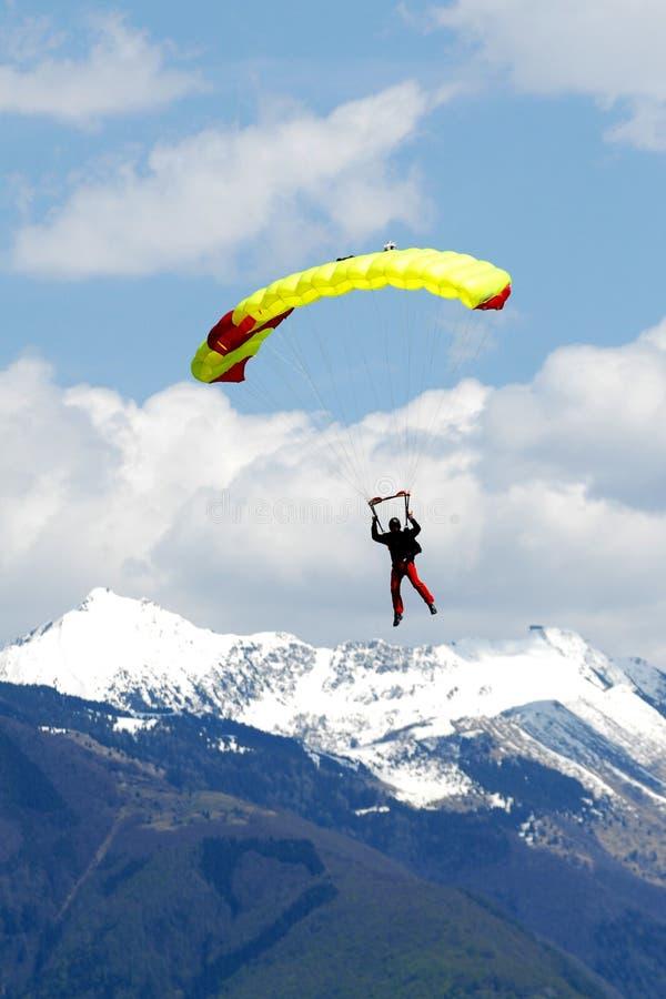 Extreem sports. parachuting. Under a blue sky royalty free stock photo