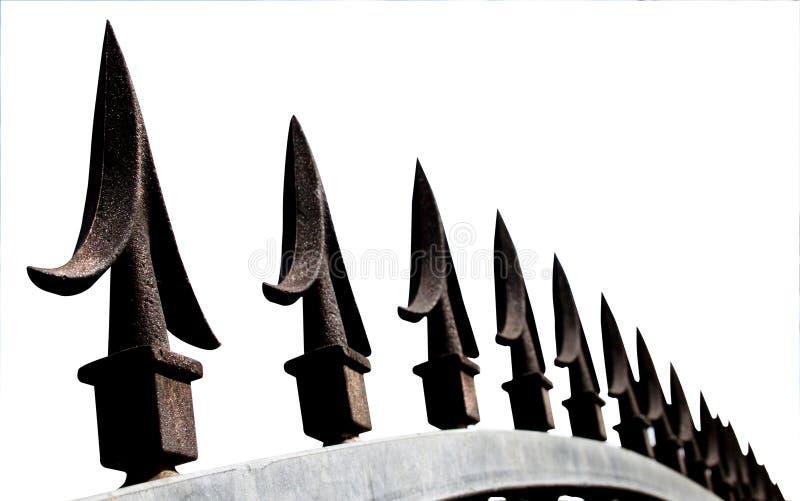 Extrem Closeup av dekorativa grova spikar för säkerhetsport royaltyfri bild
