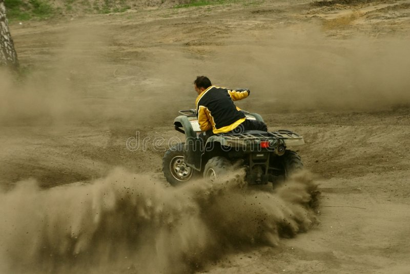 Extreme atv quad. Madness atv driver on cross terain road stock images