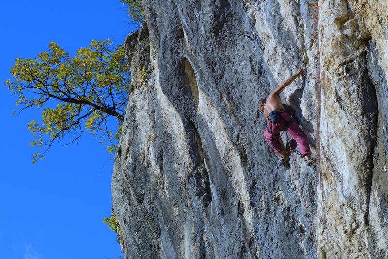 Extreme autumn, rock climbing. On the mountain royalty free stock images