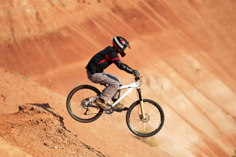 Extreme biker. In red canyon stock photography