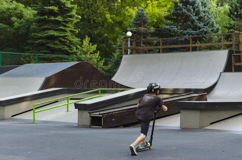 Extreme BMX rider in helmet jump in skatepark on competition. Sport kick skate concept for billboard. royalty free stock photo