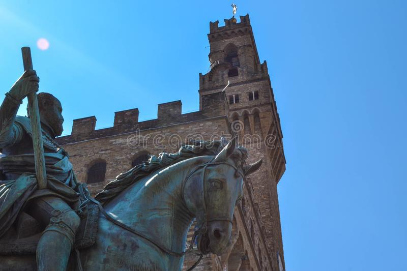 Extreme close up of the Equestrian Monument of Cosimo I with Pal. Azzo Vecchio at background in Piazza della Signoria. Florence, Italy royalty free stock photos