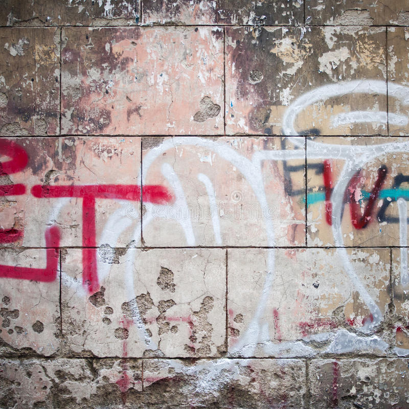 Extreme close up of graffiti on concrete wall stock photography