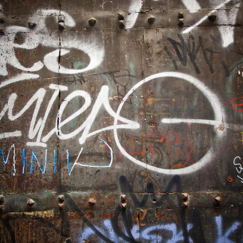Extreme close up of graffiti on wood door stock photo