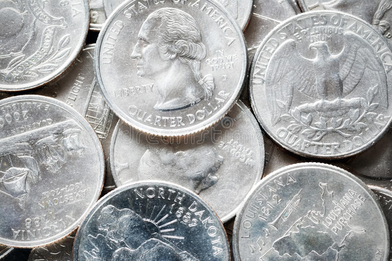 Extreme close up picture of United States quarter dollar coins. stock images