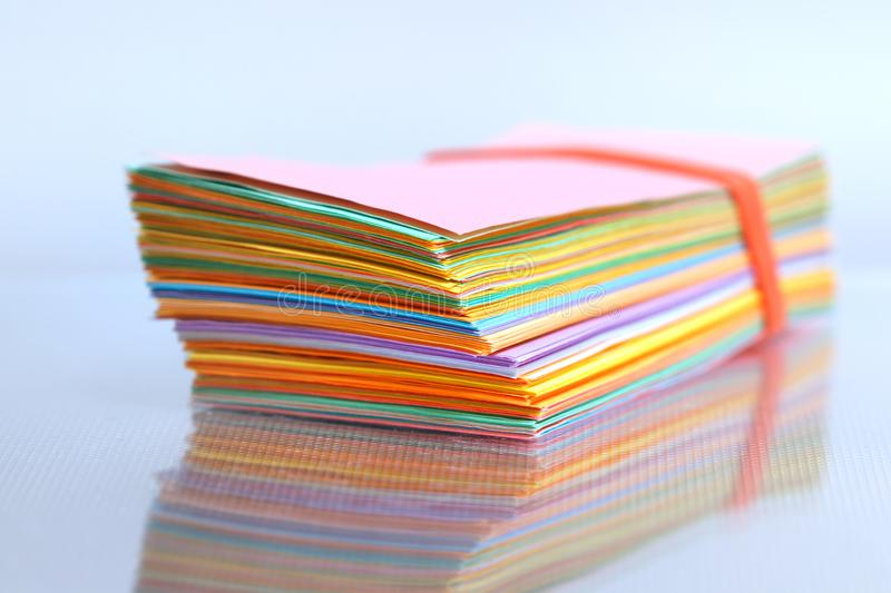 Close up shot of stack of color papers stock photo