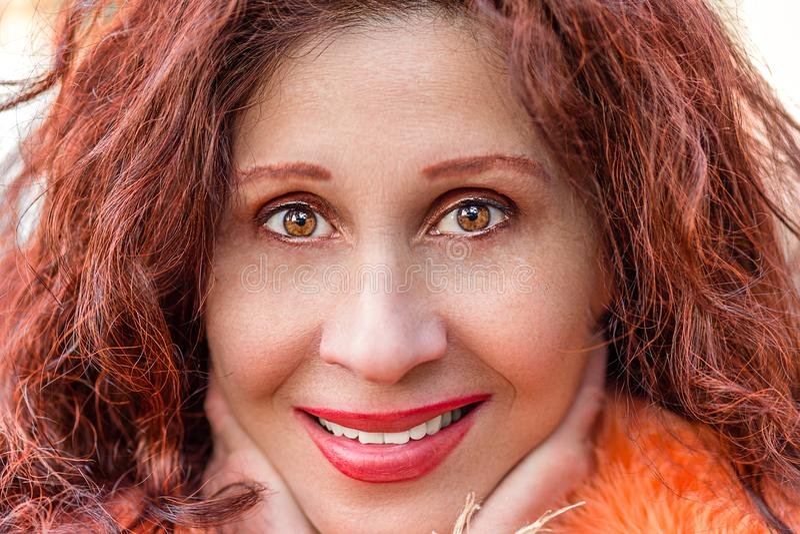 Extreme Close Up of smiling mature woman stock photos
