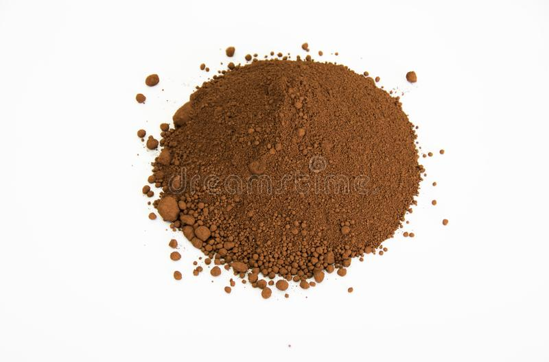 Umber pigment isolated over white. Extreme close up of umber pigment isolated over white background royalty free stock photos