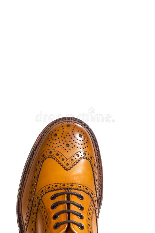 Extreme Closeup of Medalion of One Separate Male Tan Brogues. Extreme Closeup of Medalion of One Separate Male Tan Brogue Oxford Shoe. Isolated Over White stock photo