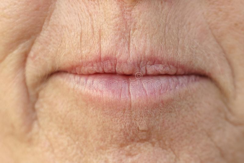 Extreme Closeup on the mouth of a middle-aged woman royalty free stock photo