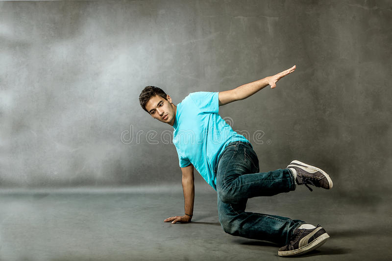 Extreme Dance. Photo of a dancer who is performing extreme break dance movements royalty free stock photos