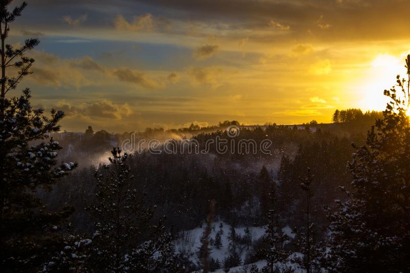 A fiery snowfall high in the mountain royalty free stock photo