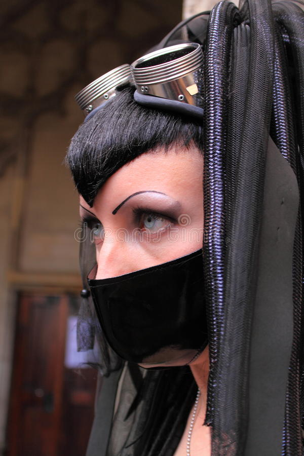 Extreme gothic fashion. Gothic woman wearing black face mask as protest against air pollution during the gothic festival summer darkness in the city utrecht, the stock photos