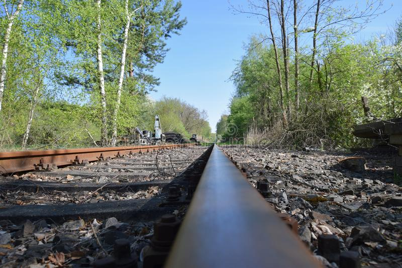 Extreme low angle shot of an old Railroad track. In Brandenburg, Germany on a sunny day in summer royalty free stock photography