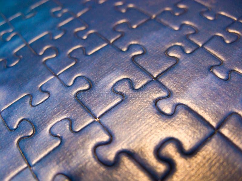 Extreme macro of blue puzzle pieces stock photos