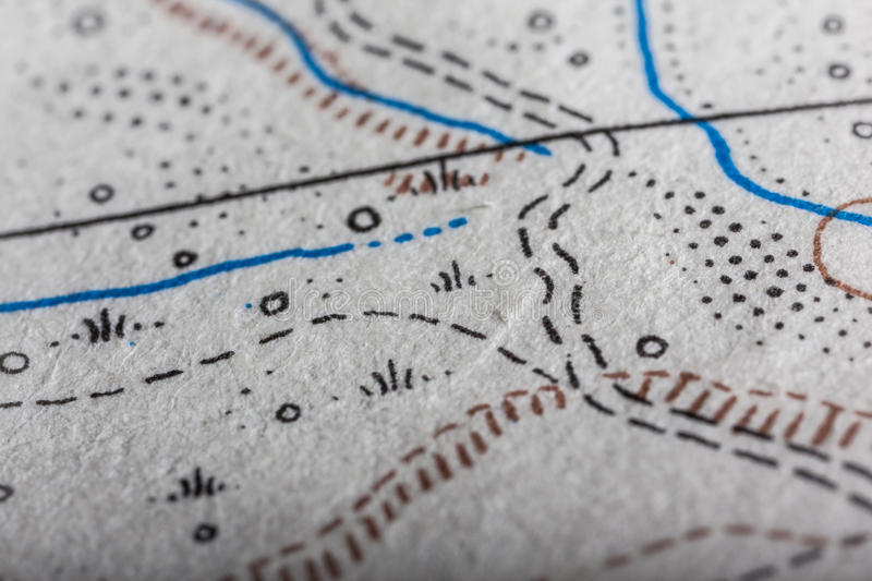 Extreme map macro. Detail of an old and worn military map stock photography