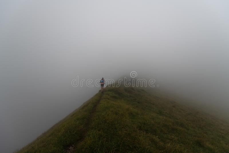 Extreme mountain race competition skymarathon. runner on a ridge stock photo