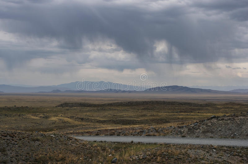 Extreme rocky road on a mountain highland desert stone tundra steppe royalty free stock photo