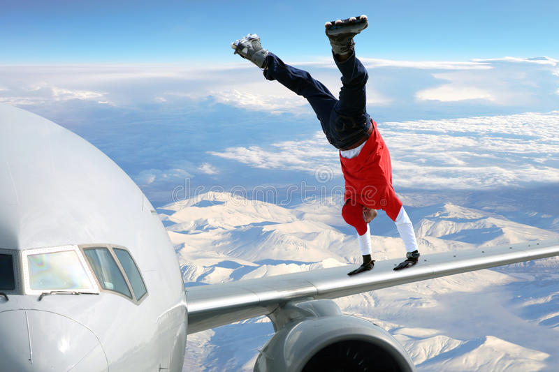 Extreme sport. On on the plane wing royalty free stock photography