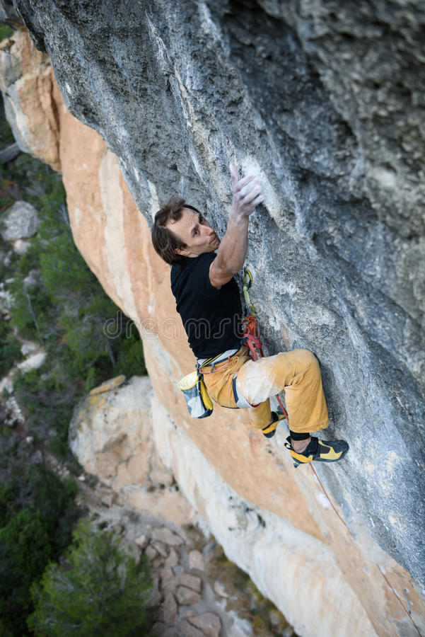 Extreme sport climbing. Rock climber struggle for success. Outdoor lifestyle. stock image