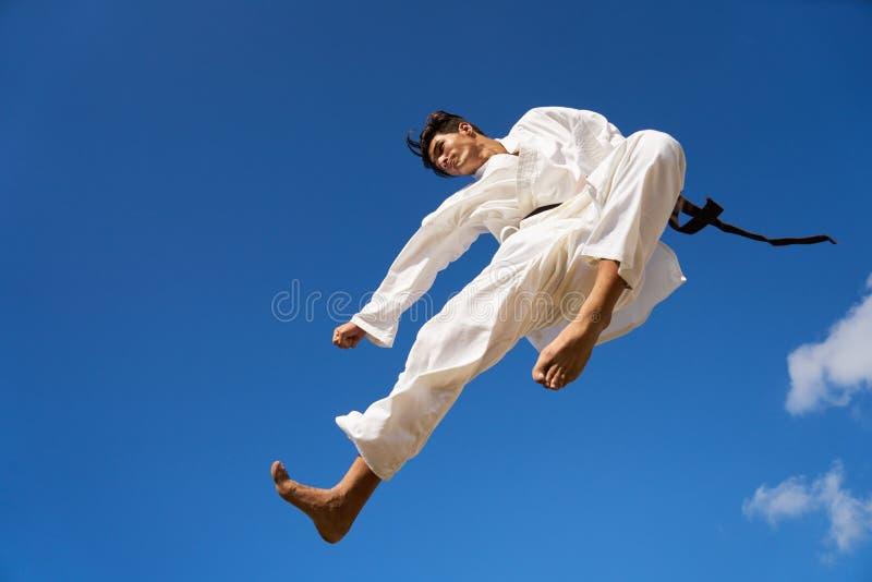 Extreme Sport Hispanic Athlete Jumping During Karate Fight royalty free stock photos