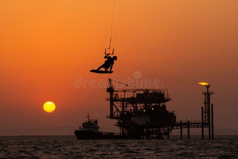 Kitesurfing against Offshore Jack Up stock photo