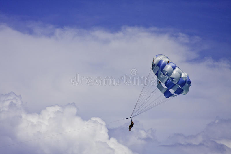EXTREME SPORT. Parachute off the Caribbean Sea. Clouds in the sky shine particularly with free space left for text royalty free stock photos