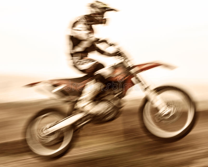 Extreme sport. Slow motion on motorbike, pro race driver jumping on the dirt bike, motocross, speed and challenge concept stock image