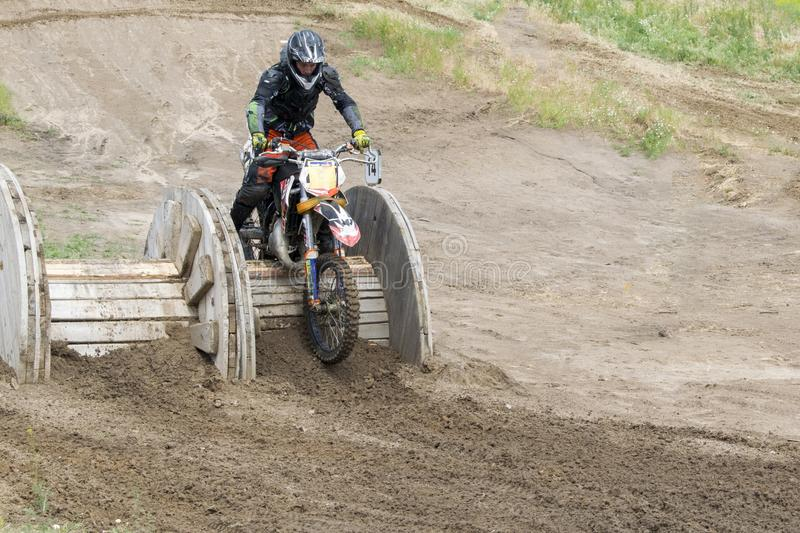 Extreme sports on motorcycles. A rider on a motorcycle rides the sand. royalty free stock photography