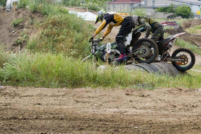 Extreme sports on motorcycles. A rider on a motorcycle rides the sand. stock photos