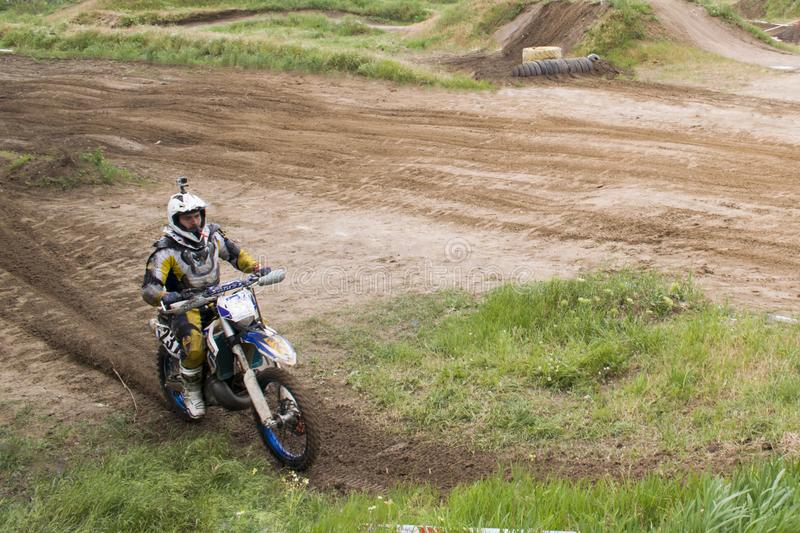 Extreme sports on motorcycles. A rider on a motorcycle rides the sand. royalty free stock images