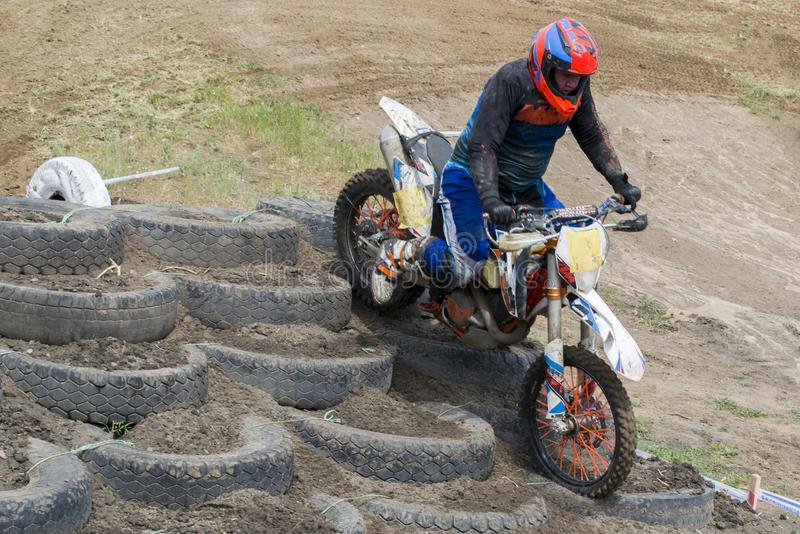 Extreme sports on motorcycles. A rider on a motorcycle rides the sand. stock image