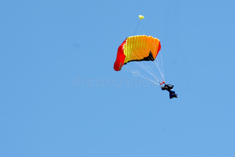 Extreme sports. parachuting. Under a blue sky royalty free stock image