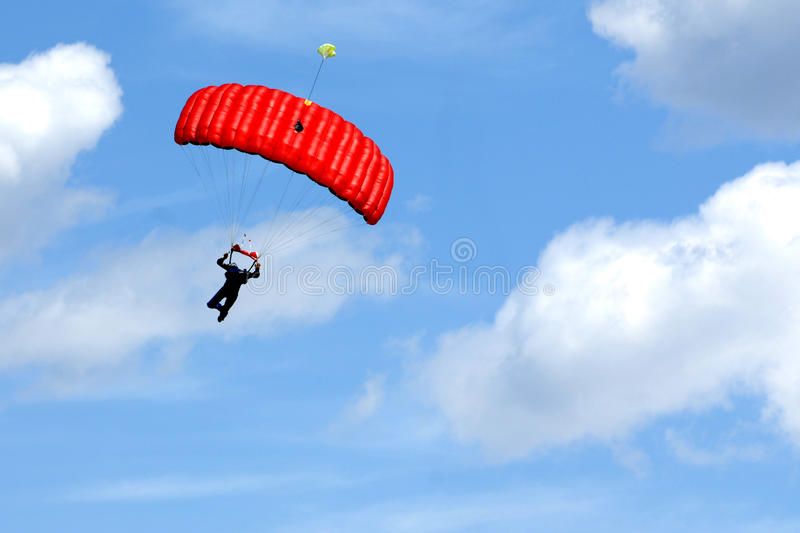 Extreme sports. parachuting. Under a blue sky royalty free stock images