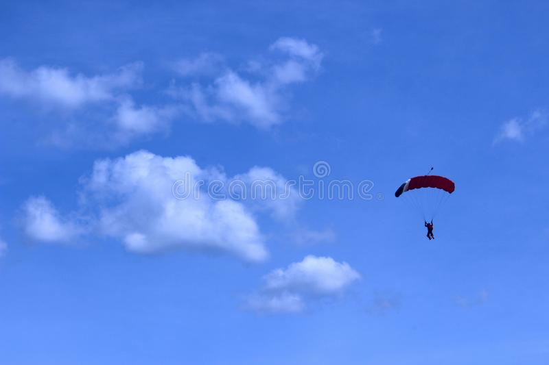 Extreme Sports. Parachuting, Hang Gliding and Paragliding. Skydiver In Blue Sky. Active Hobby.Skydiving.Abstract Nature Background.Extreme Sports. Parachuting royalty free stock photo