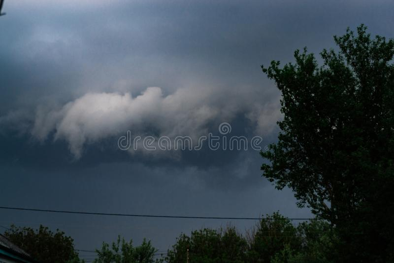 Extreme thunderstorm shelf cloud. Summer landscape of severe weather.  stock photos