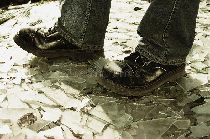 Extreme walking. On smashed glass stock images