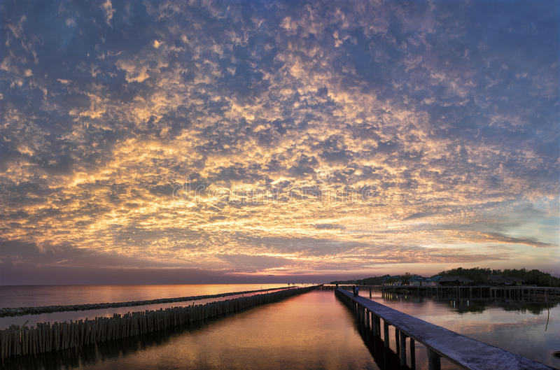 Extremely amazing sky at dawn over seashore royalty free stock photos