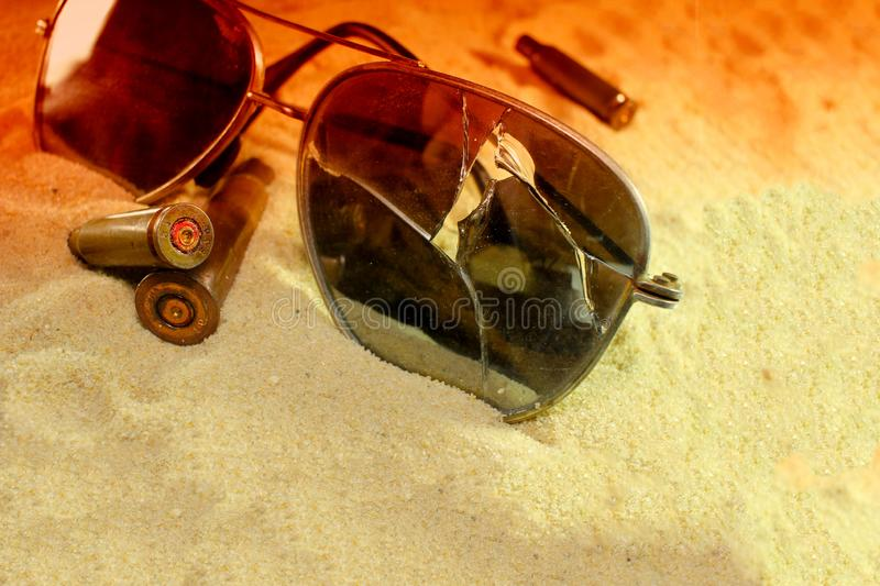 Extremely close-up of ammunition in the sand, the concept of conflict, human sacrifices of peaceful people. Of ammunition in the sand royalty free stock photo