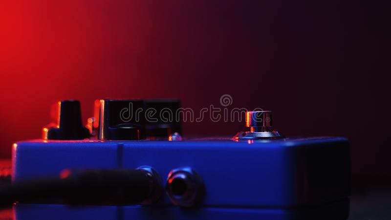 Close-up of spinning reel. Old 8mm film projector showing film at night in dark room. Vintage retro objects royalty free stock photography