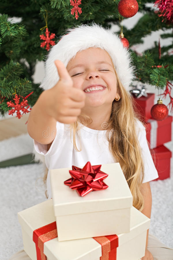 Extremely happy litte girl with christmas present royalty free stock images