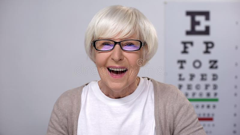 Extremely happy retired woman enjoying perfect eye sight in new glasses, health stock image