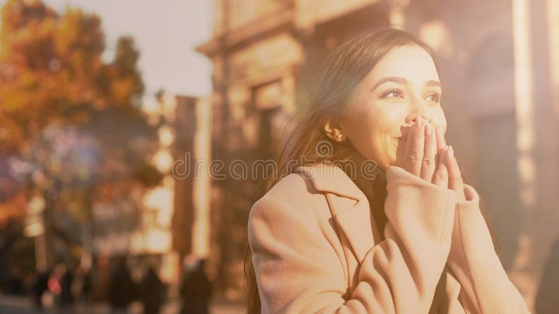 Extremely happy young lady feeling inspired, dream come true, new life beginning stock photos