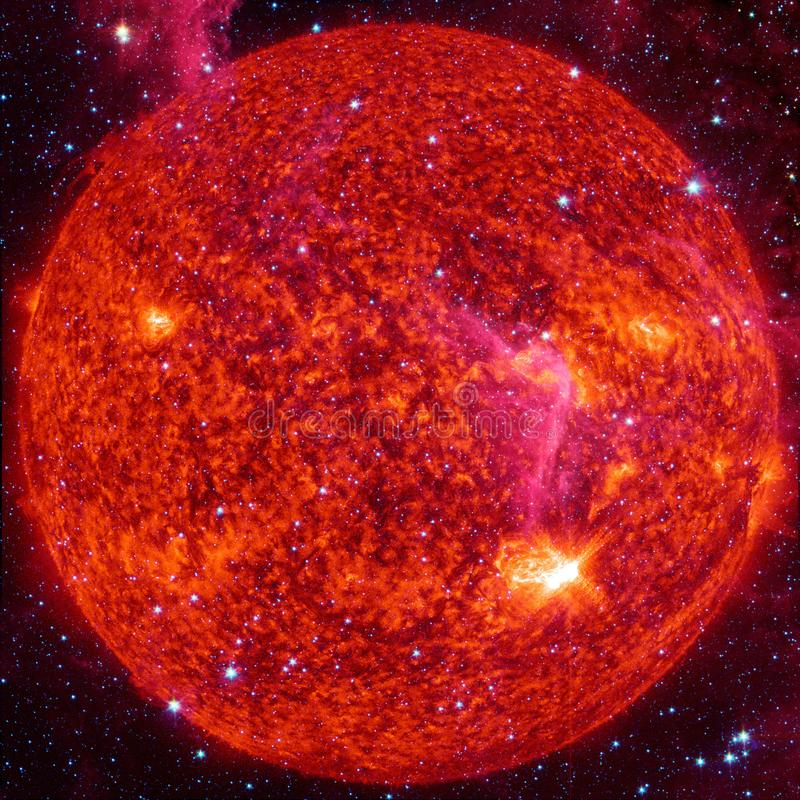 Extremely hot star. Flaring of Sun. Elements of this image furnished by NASA. Extremely hot star. Flaring of Sun. Beauty of endless universe. Elements of this royalty free stock photo