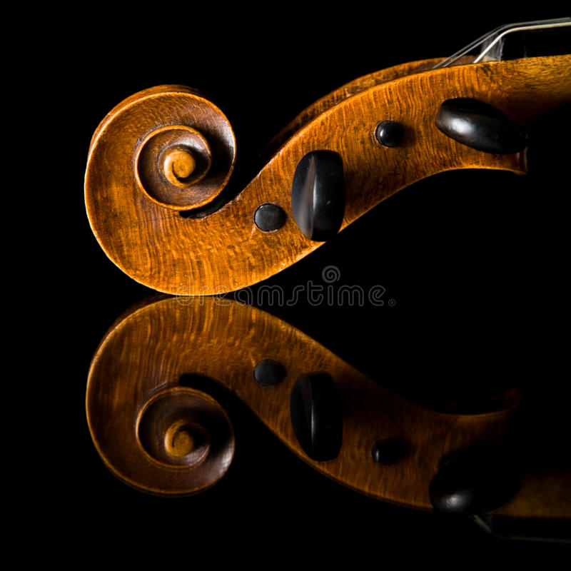 Extremely old scratched violin pegbox and scroll, stock images