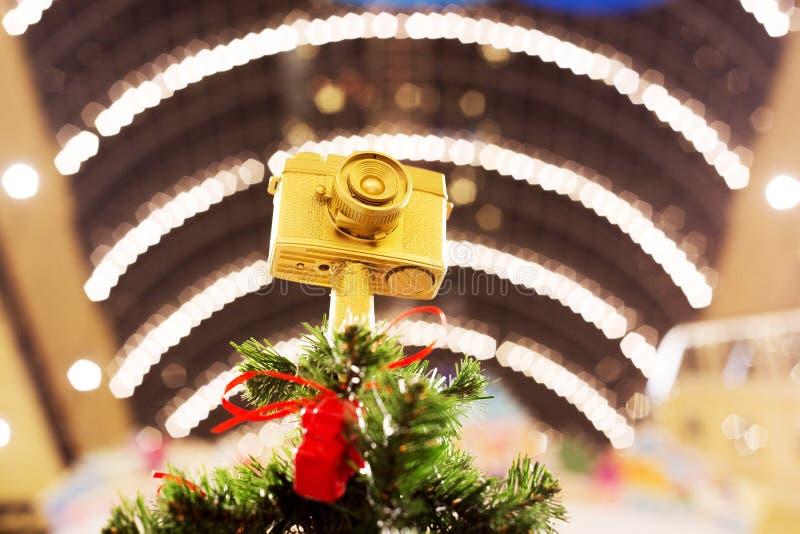 Extremidad de la cima del abeto de la Navidad del oro, decoración superior como cámara fotografía de archivo