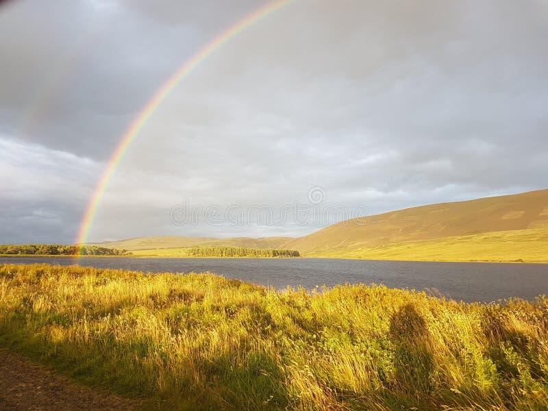 Extremo de un arco iris fotos de archivo libres de regalías