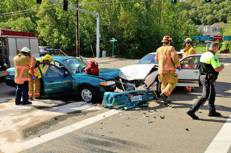 Extrication. Fire fighters and paramedic emt personnel extricate the victim of a two vehicle head on accident at an intersection in Roseburg, OR on August 27 stock photos